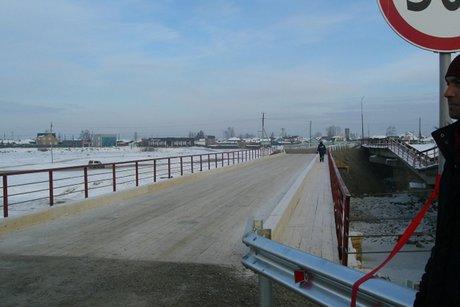 ВИркутской области открыли кратковременный мост через реку Куда