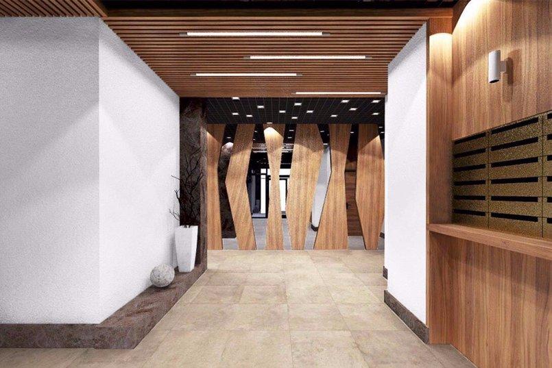 Интерьер общественных зон будет выполнен в светлых тонах с использованием деревянного декора и зеркал