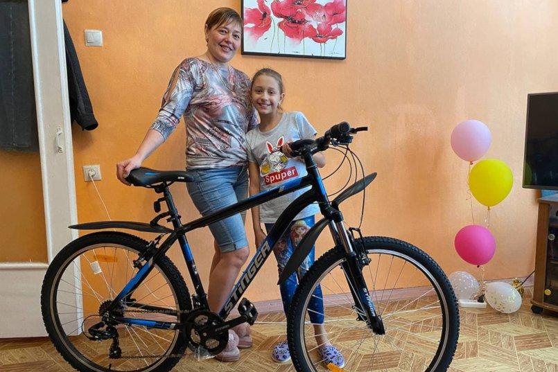 Анна попросила для своей мамы велосипед